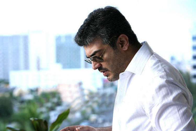 Ajith Kumar in white shirt standing