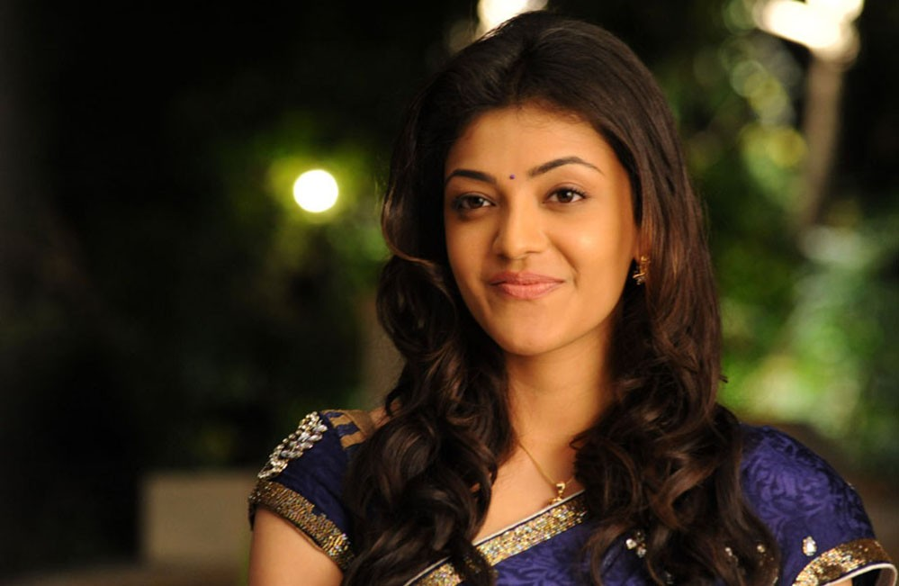 Kajal Aggarwal smiling in saree