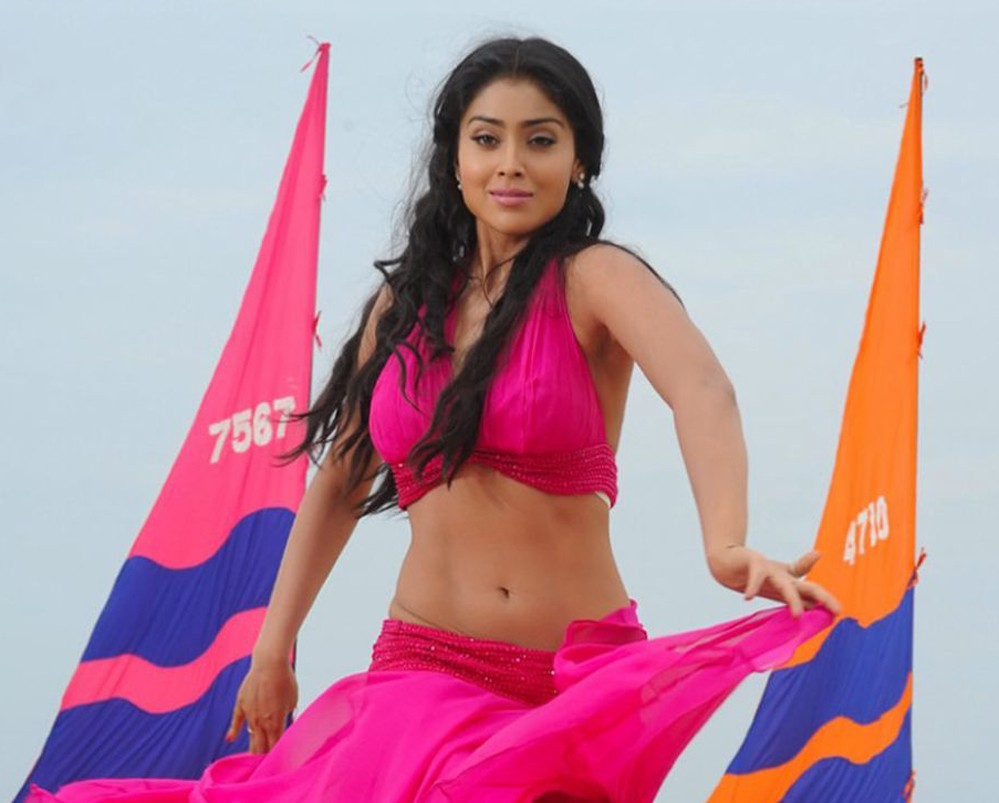 Shriya Saran hot in red at beach