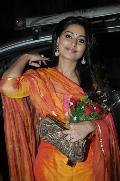 Actress Sneha real life photo in orange sudithar