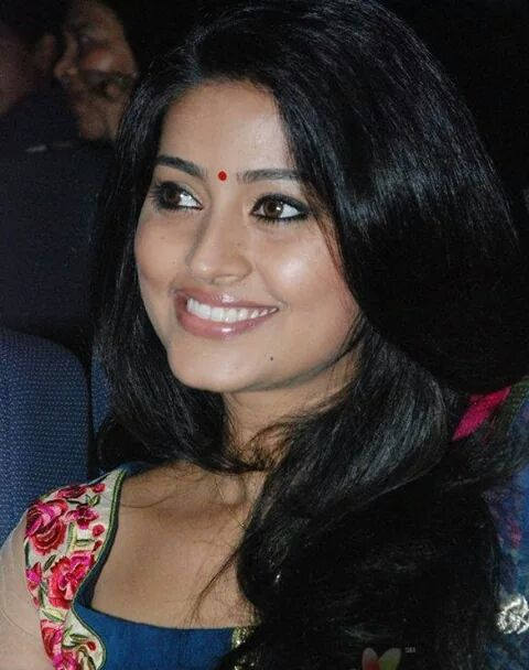 Actress Sneha smiling