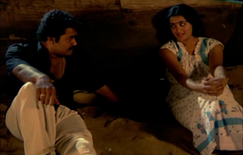 Mohanlal and Sumalatha in Thoovanathumbikal at a Beach