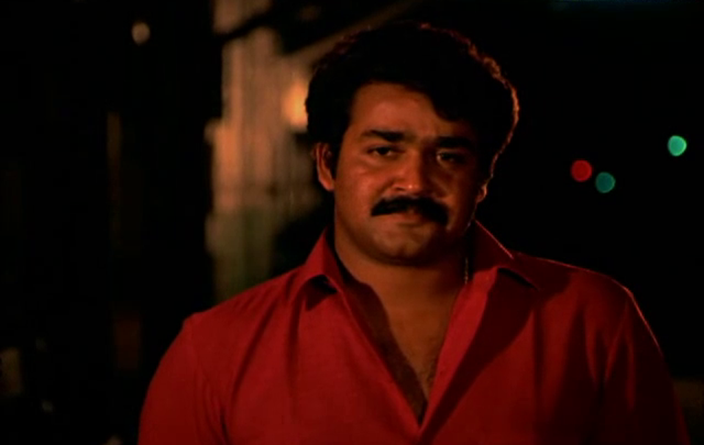 Mohanlal in red shirt Thoovanathumbikal