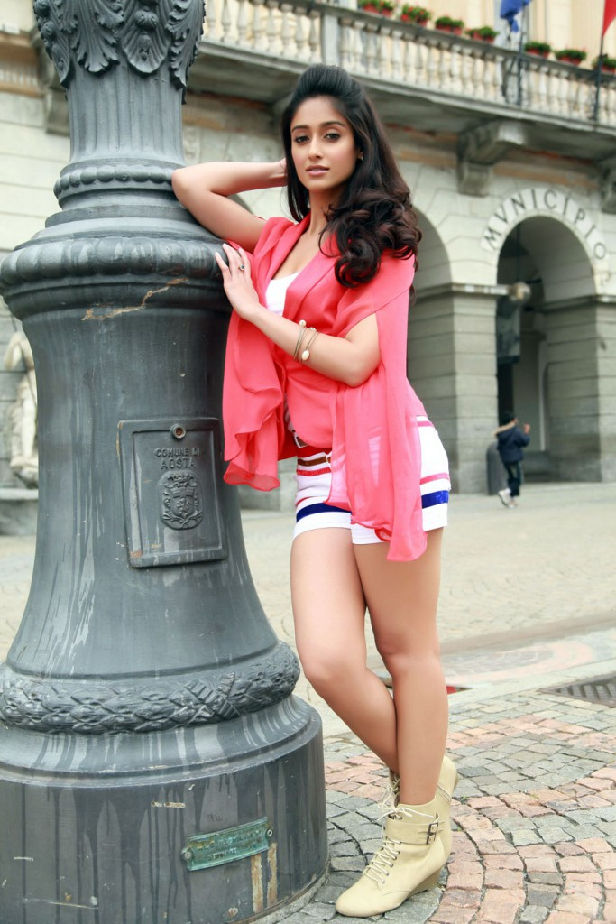 Ileana in shorts posing for a photo