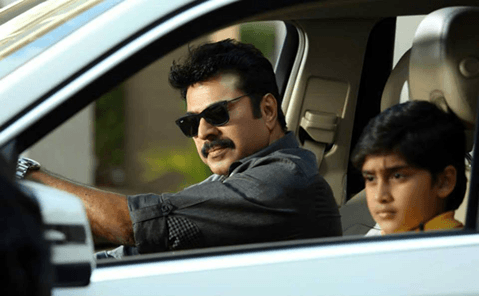 Mammootty driving with sun glass