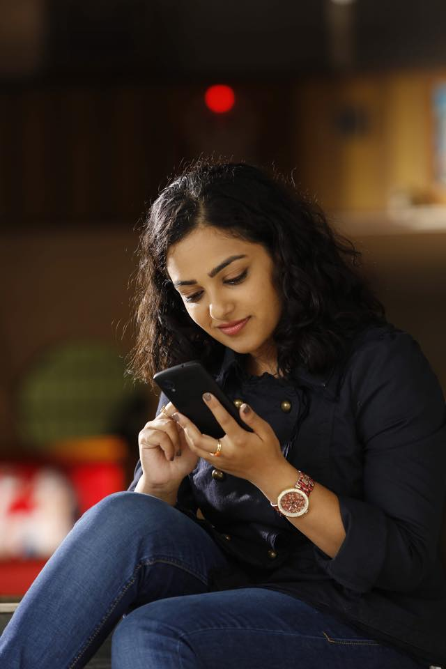 Nithya Menon with mobile phone