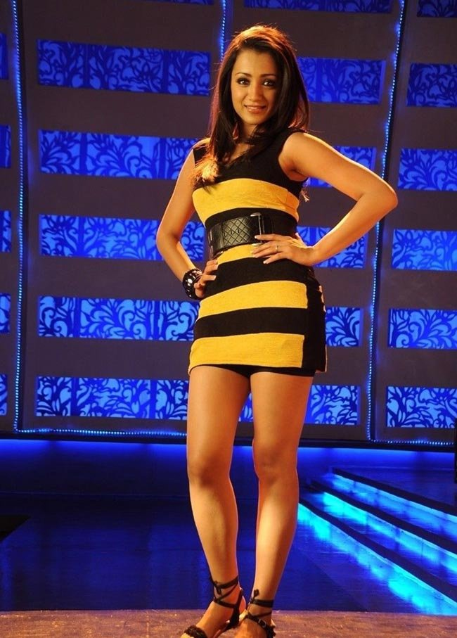 trisha yellow and black dress during a song scene