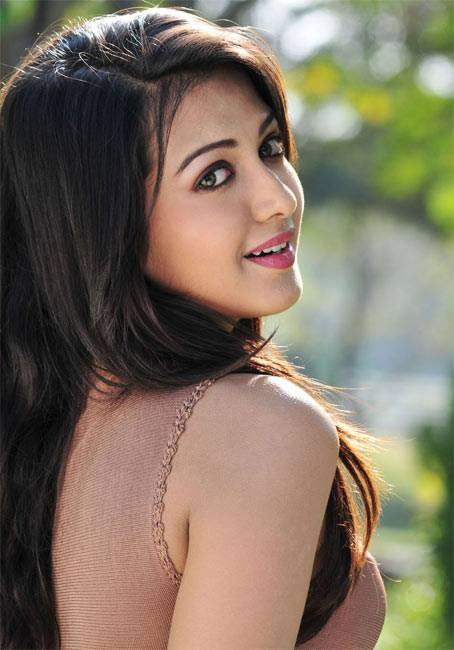 Catherine Tresa smiling side view