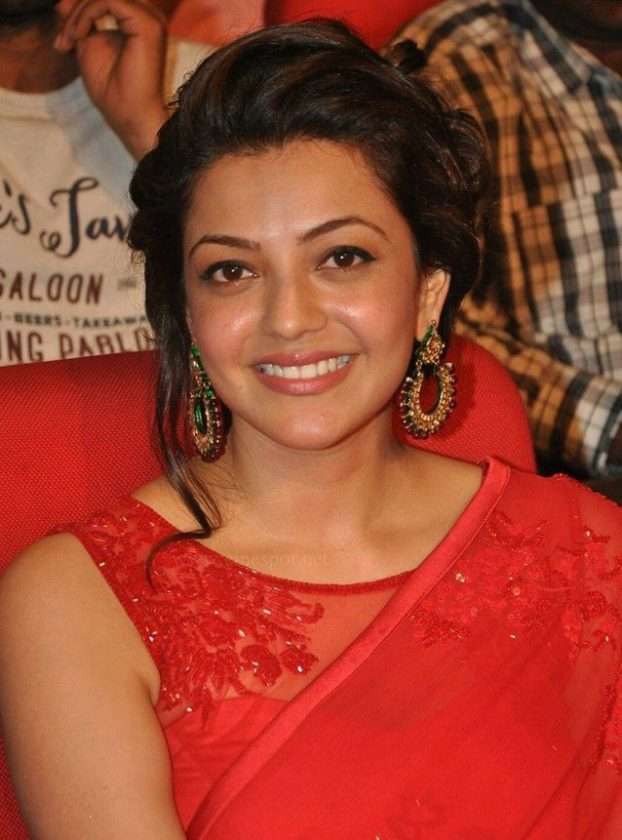 Kajal Aggarwal in red smiling real life