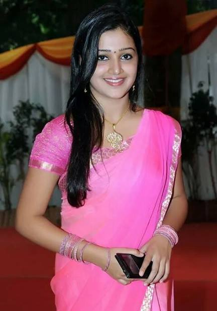 Samskruthy Shenoy in pink saree during a film function