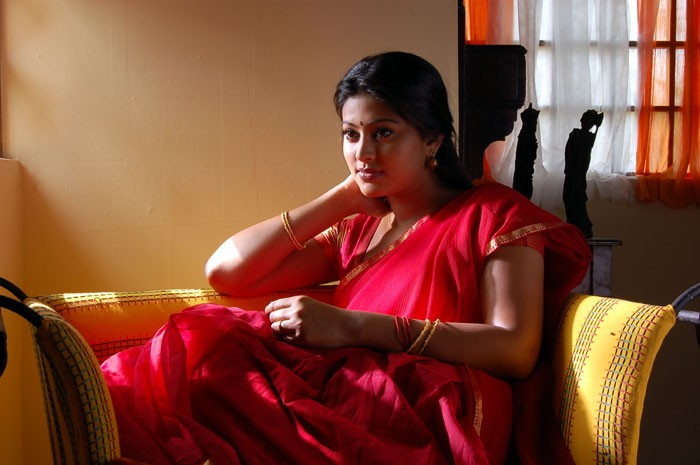 Tamil actress Sneha in red saree