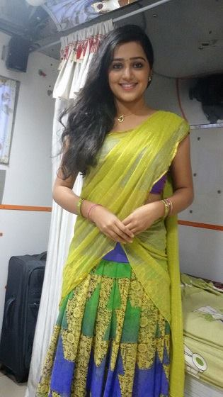 Samskruthy Shenoy in green half saree