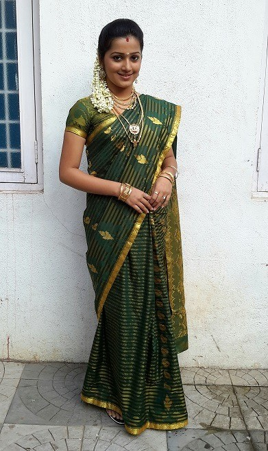 Samskruthy Shenoy in green saree village getup