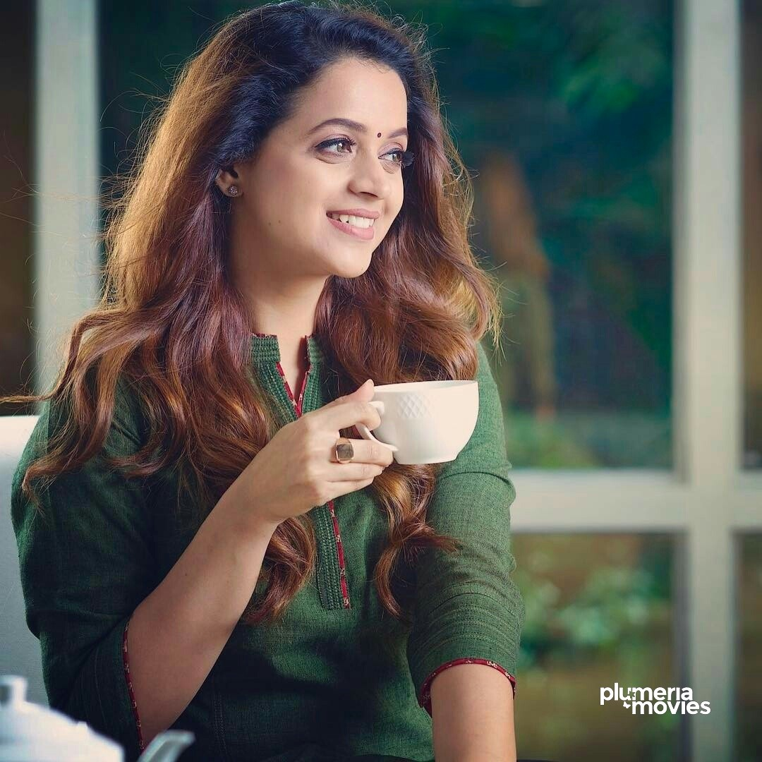 Indian Actress Bhavana Menon drinking tea