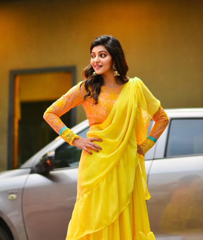 Athulya in Yellow and Orange