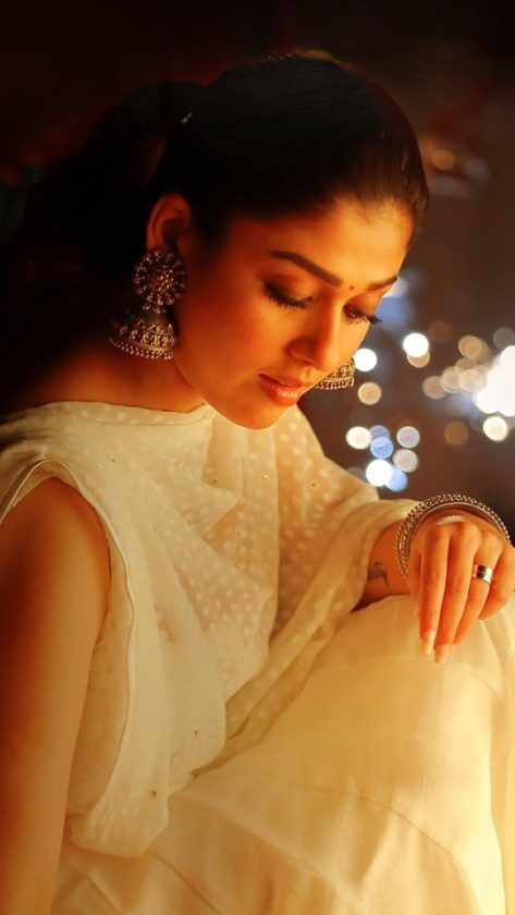 Nayanthara sitting on floor in a temple