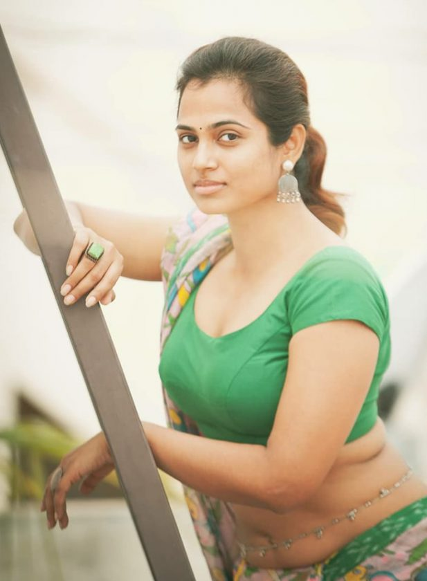 Hot Tamil actress Ramya Pandian on roof top during a photoshoot
